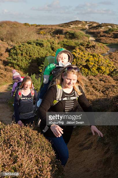 mother and baby coastal walk - s0ulsurfing stock pictures, royalty-free photos & images