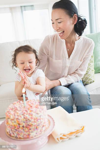 Mother and baby daughter celebrating birthday