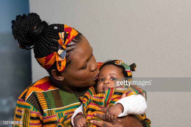 mother and baby daughter traditional love - zulu women stock pictures, royalty-free photos & images