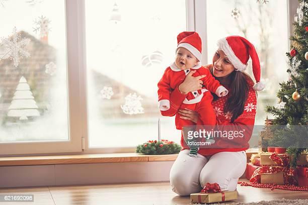 Mother and baby enjoying Christmas