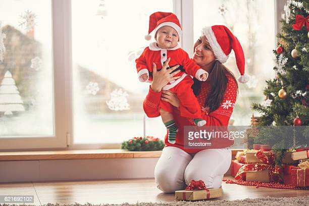 Mother and baby enjoying Christmas