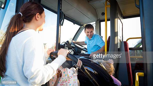 Mother and Baby Getting on Bus