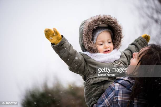 Mother and baby girl enjoying outdoors in winter