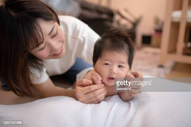 mother and baby girl playing together - japanese mom stock photos and pictures