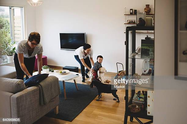 Mother and baby girl playing while women working at home