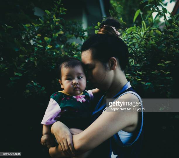 mother and baby girl with arms raised - unknown gender stock pictures, royalty-free photos & images