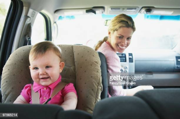 Mother and Baby in a Car Seat