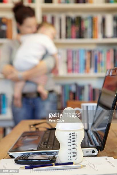 mother and baby in library working