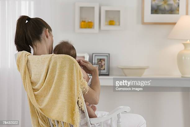 Mother and baby in rocking chair