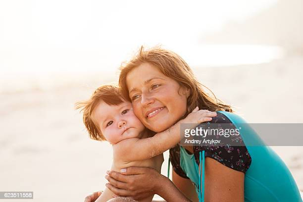 mother and baby on a beach