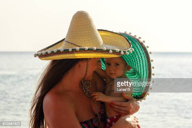 mother and baby on the beach - europäischer abstammung stock pictures, royalty-free photos & images