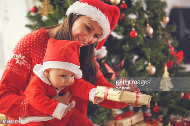 Mother and baby opening Christmas present