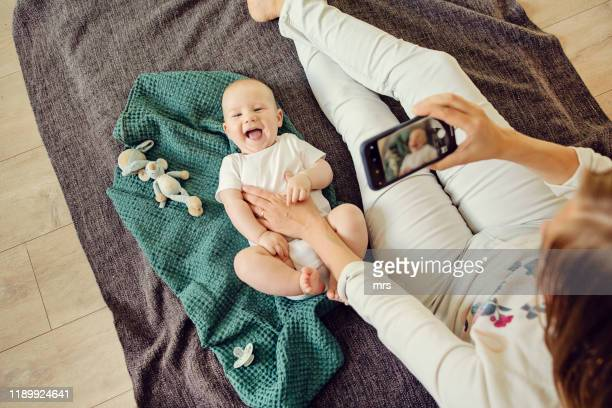 mother and baby - photo messaging stock pictures, royalty-free photos & images
