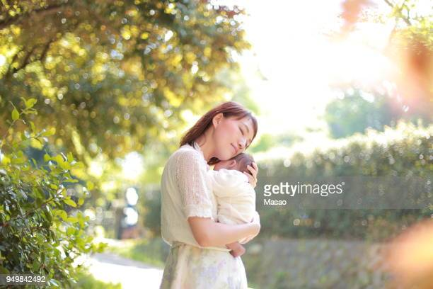 mother and baby - japanese mom stock photos and pictures