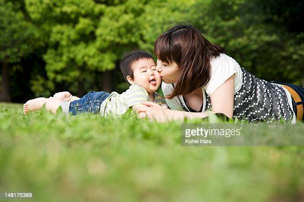 mother and baby playing in the park