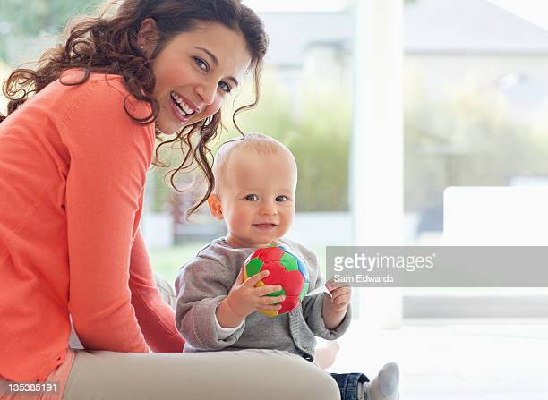 Mother and baby playing with ball