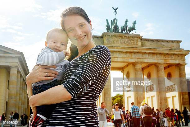 Mother and baby posing at Brandenburger Tor