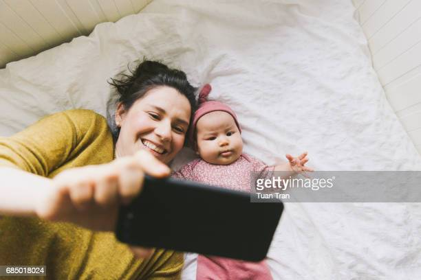 Mother and baby posing for cell phone
