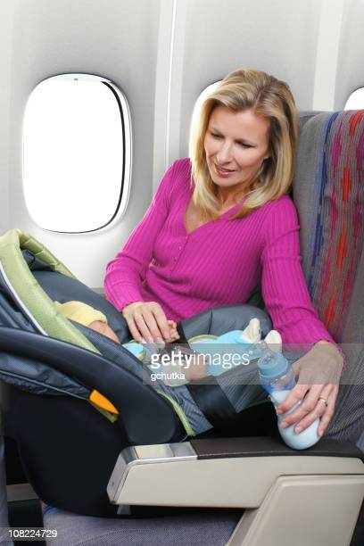 Mother and Baby Sitting in Airplane Seats