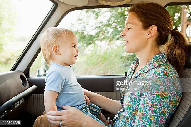 Mother and baby son in vehicle