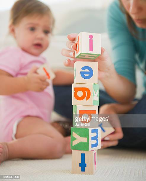 Mother and baby stacking blocks together