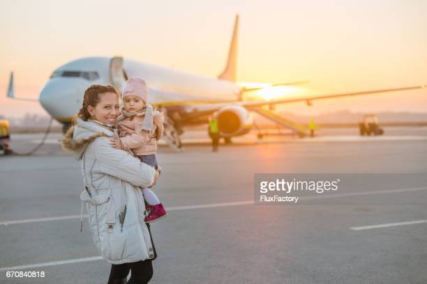 Mother and baby traveling with a plane