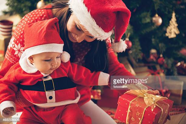 Mother and baby with Christmas present