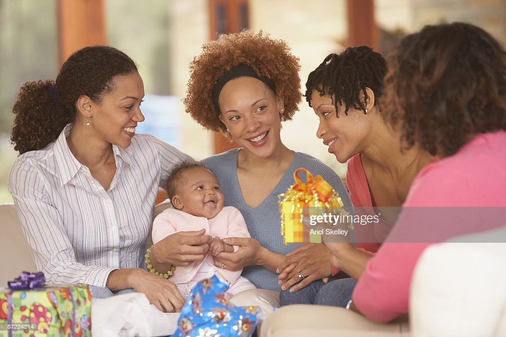 Mother and baby with friends at baby shower : Stock Photo