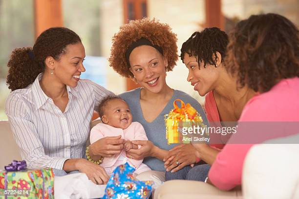 mother and baby with friends at baby shower - baby shower stock photos and pictures