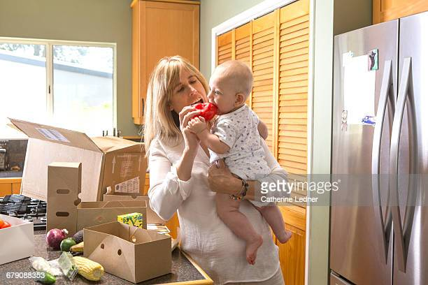 Mother and baby with home delivered food