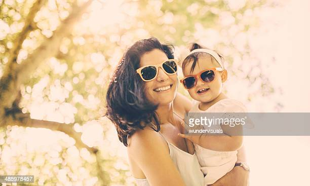Mother and baby with sunglasses