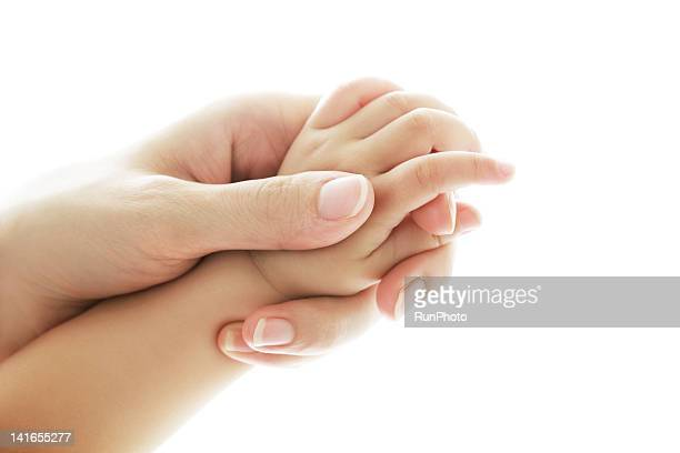 mother and baby's hand