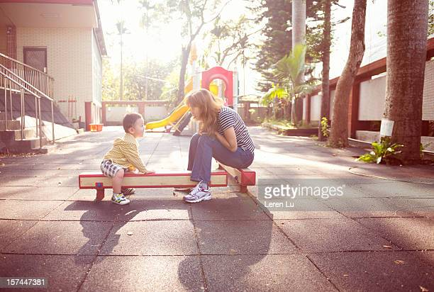 Mother and boy play in the playground