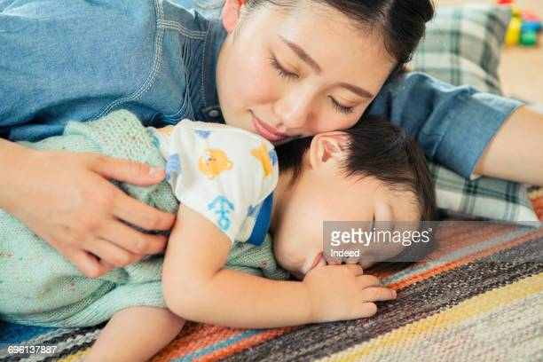 Mother and boy resting on floor