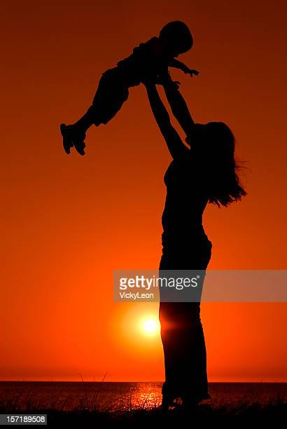 mother and child 2 - mothers day beach stock pictures, royalty-free photos & images