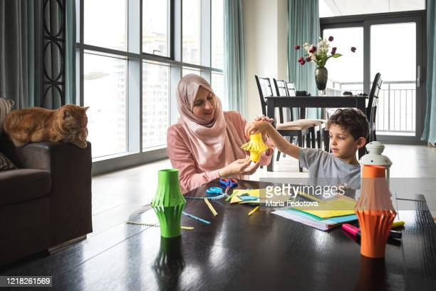 mother and child are making decorations for ramadan - ramadan decoration stock pictures, royalty-free photos & images