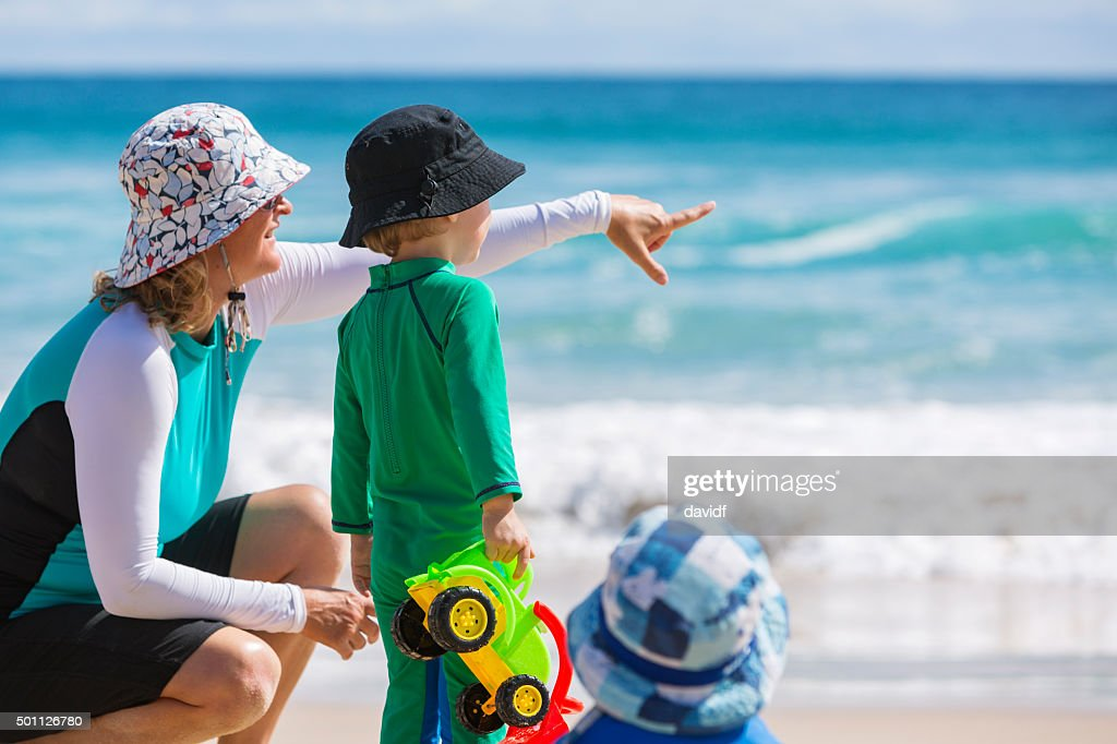 Mother and Child at the Beach With Sun Protection : Stock Photo