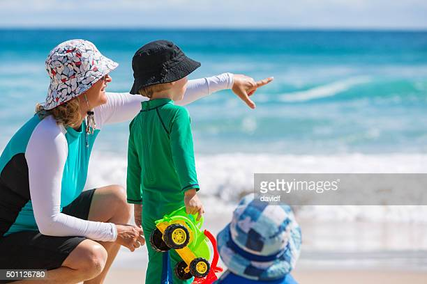 Mother and Child at the Beach With Sun Protection