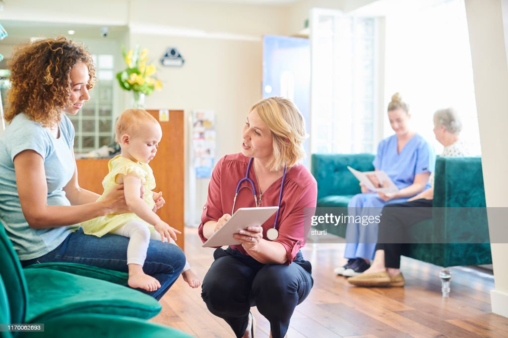 mother and child at the clinic : Stock Photo
