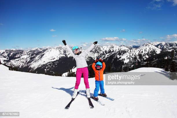 mother and child being silly and happy on the ski slope - ski pants stock pictures, royalty-free photos & images