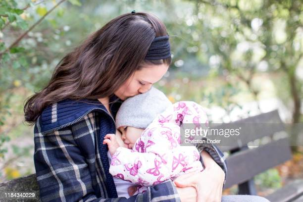 mother and child breastfeeding - woman breastfeeding animals stock photos and pictures