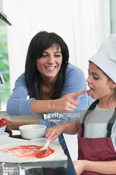 Mother and child cooking together.