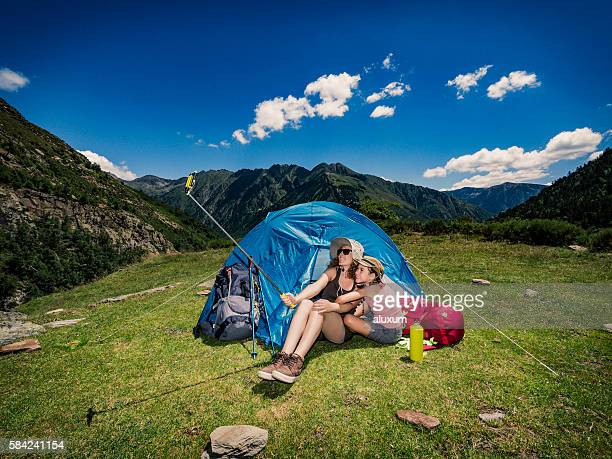 Mother and child doing a selfie photograph at camping tent