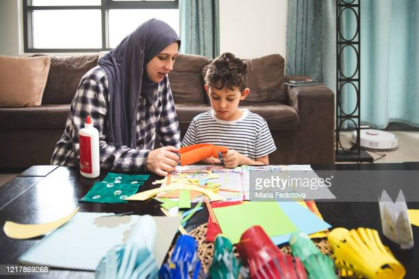 mother and child doing creative activities together - united arab emirates stock pictures, royalty-free photos & images