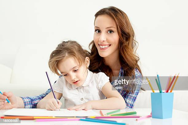 Mother and child drawing coloring book.