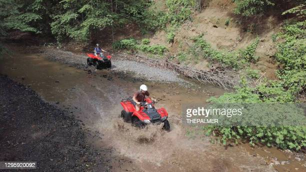 mother and child driving off-road vehicles drone point of view - ireland stock pictures, royalty-free photos & images
