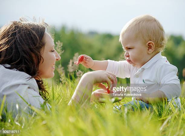 Mother and child eating berries