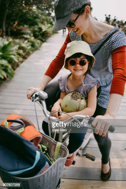 Mother and child enjoying bicycle ride