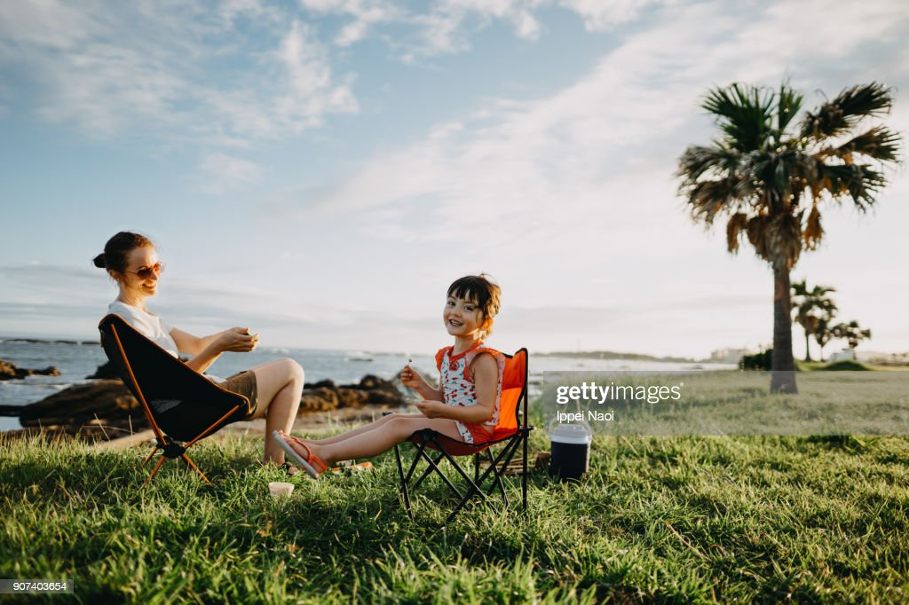 Mother and child enjoying camping by the sea : Stock Photo