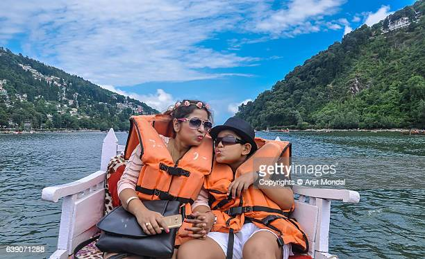 Mother And Child Enjoying Playful Pedal-boat Ride at Bhimtal Lake